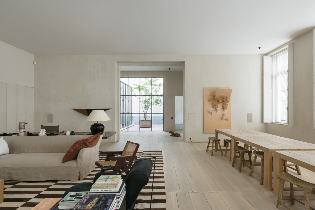 Vincent van Duysen's spacious interior, where the furniture acts as a partition.  The same technique is suitable for smaller apartments, as well as for studios.  Source: vincentvandyusen.com