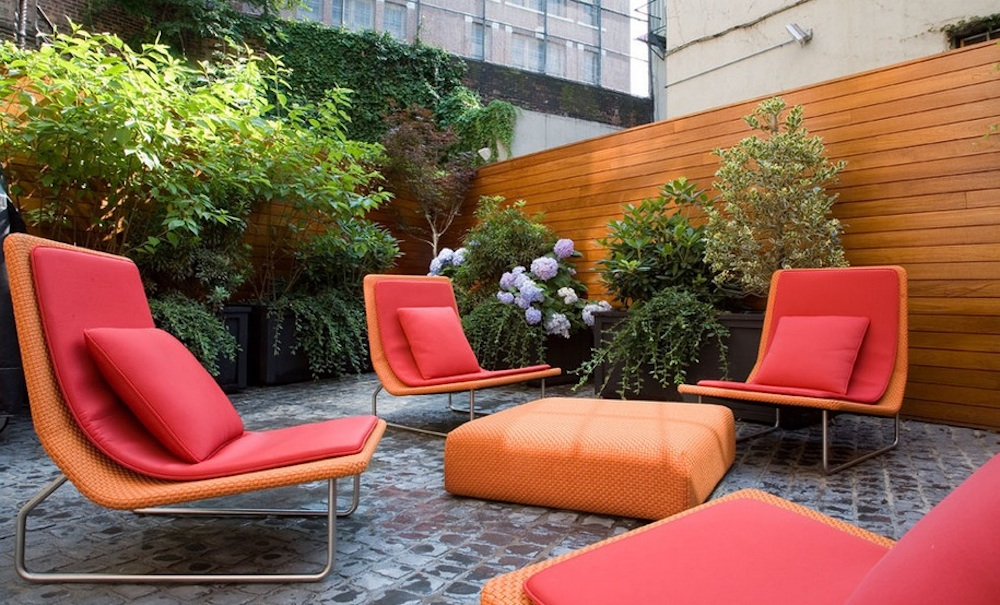 Use warm colors to stimulate lively conversation.  Photo: Axis Mundi